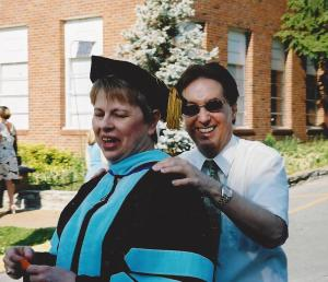 Before graduation with Dr. Patterson adjusting my hood
