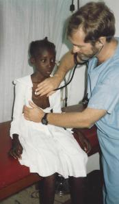 Jerry examining a young adolescent with TB