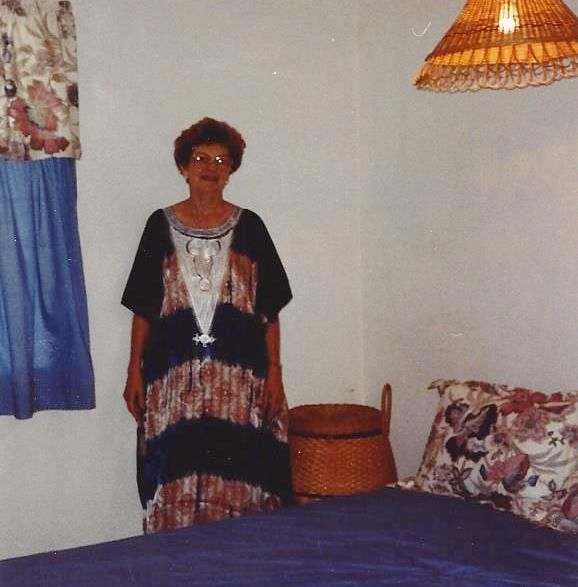 In traditional dress in her bedroom