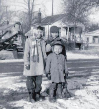 Dressed for Michigan winter with younger brothers, Steve and David