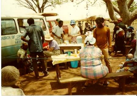 Notice the van for travel, their nursing stations (under a tree). Mama is in the back, wearing a blue hat.