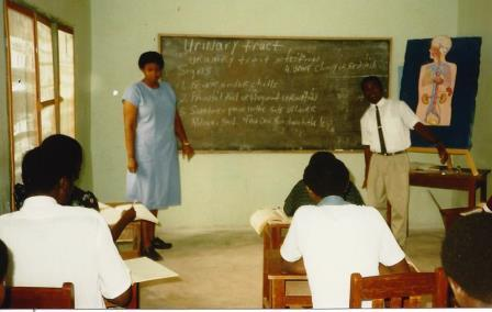 Adrienne, a nurse from California, teaching in the Bible college. Francis assists in translation when needed.