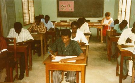 Bible college students. Avril, nurse from Canada, can be seen at the back table.